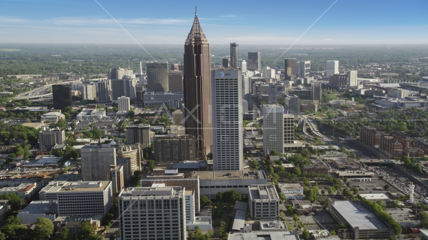 Skyscrapers towering over citiy buildings, Midtown Atlanta, Georgia Aerial Stock Photos | AX38_069.0000285F