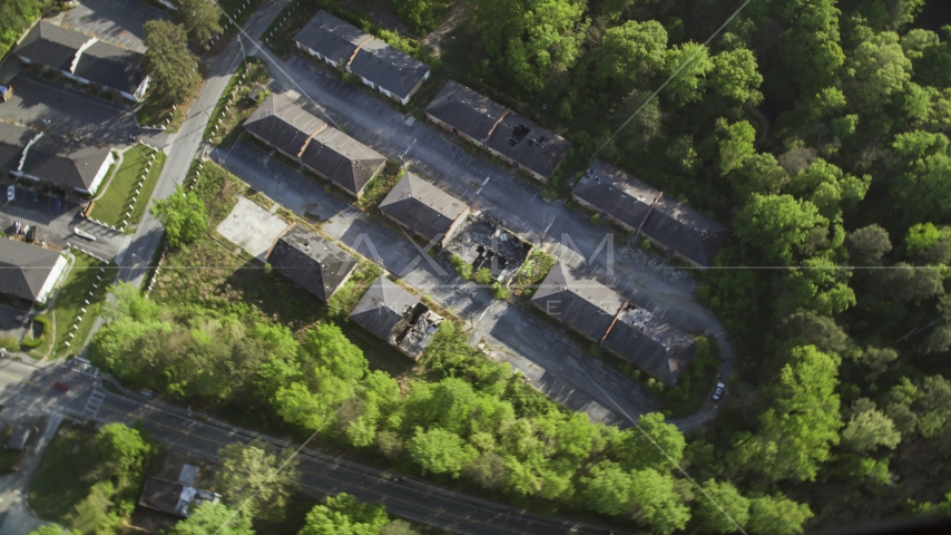 Bird's eye view of abandoned buildings among trees, Atlanta, Georgia Aerial Stock Photo AX38_081.0000041F | Axiom Images