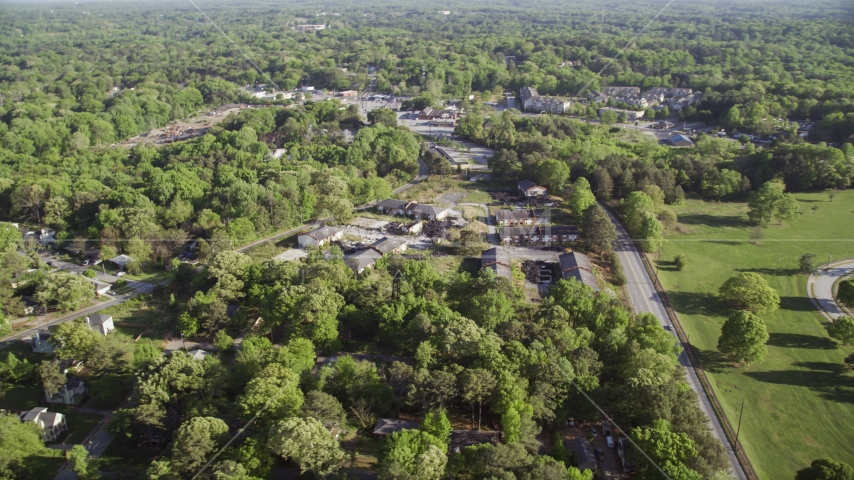 Abandoned buildings among trees, West Atlanta Aerial Stock Photos | AX38_082.0000096F