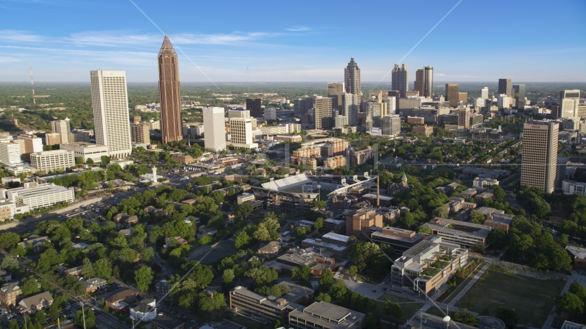 Midtown and Downtown Atlanta skyscrapers behind the Bobby Dodd Sports Stadium, Atlanta, Georgia Aerial Stock Photo AX39_028.0000127F | Axiom Images