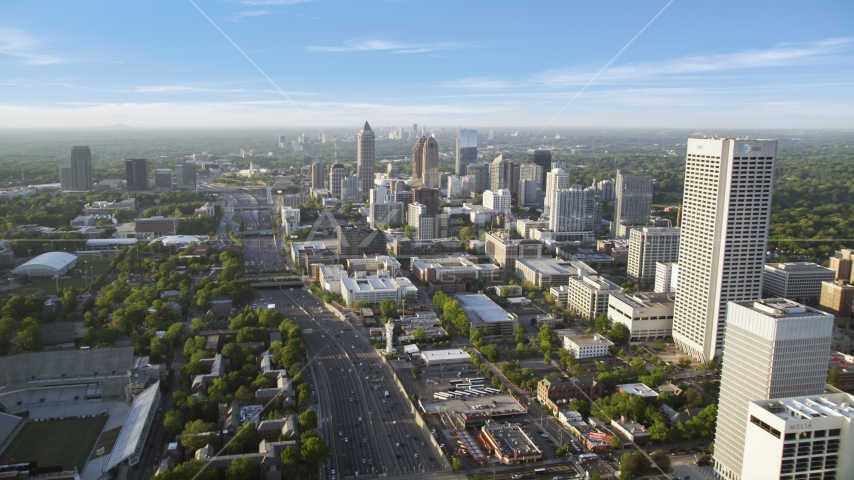 Downtown Connector along city buildings; Midtown Atlanta, Georgia Aerial Stock Photos | AX39_049.0000319F