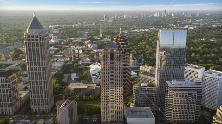 Promenade II and neighboring skyscrapers, Midtown Atlanta, sunset Aerial Stock Photos | AX39_053.0000000F
