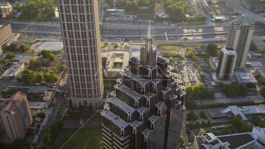 Close up of the top of Promenade II, Midtown Atlanta, Georgia Aerial Stock Photo AX39_054.0000211F | Axiom Images