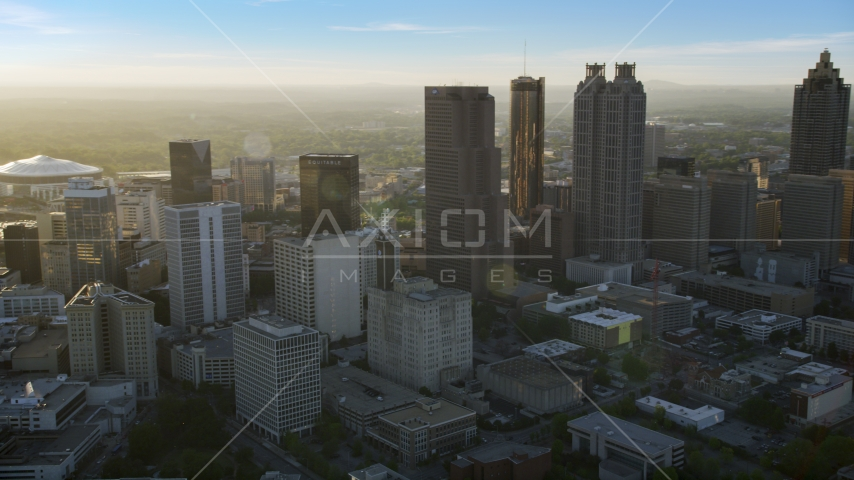 Downtown Atlanta skyscrapers at sunset with hazy skies, Georgia Aerial Stock Photos | AX39_066.0000060F