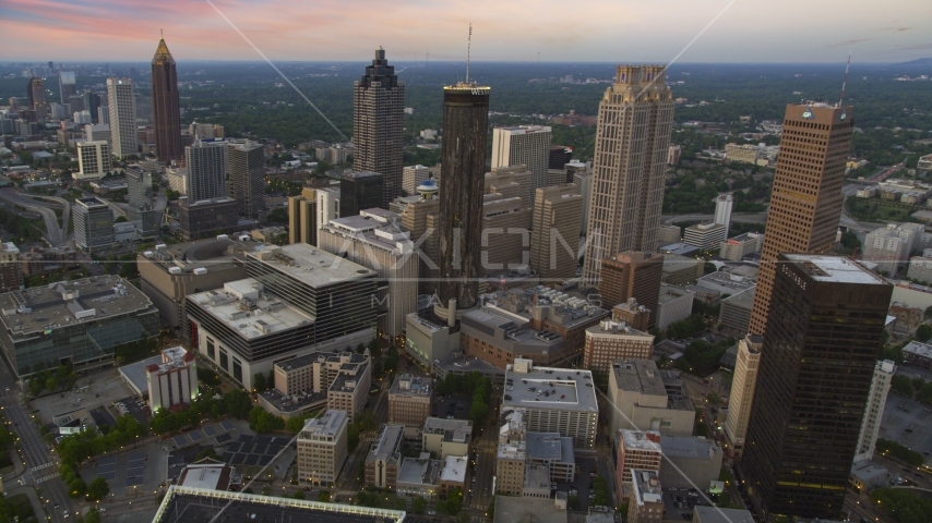 Westin Peachtree Plaza Hotel and skyscrapers in Downtown Atlanta, Georgia, twilight Aerial Stock Photos | AX40_004.0000430F