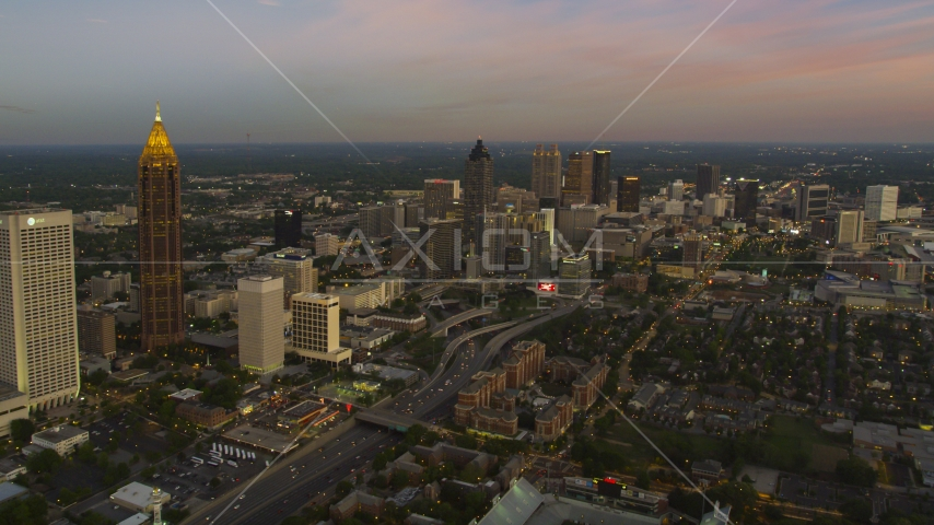 Midtown skyscrapers, Downtown skyscrapers in the background, Atlanta, Georgia, twilight Aerial Stock Photos | AX40_012.0000000F