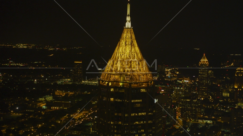 The top of Bank of America Plaza skyscraper at night, Midtown Atlanta, Georgia Aerial Stock Photos | AX41_022.0000016F