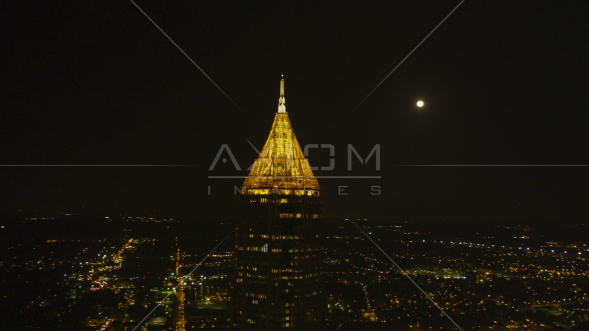 The top of Bank of America Plaza at night with moon in the background, Midtown Atlanta, Georgia Aerial Stock Photos | AX41_026.0000212F