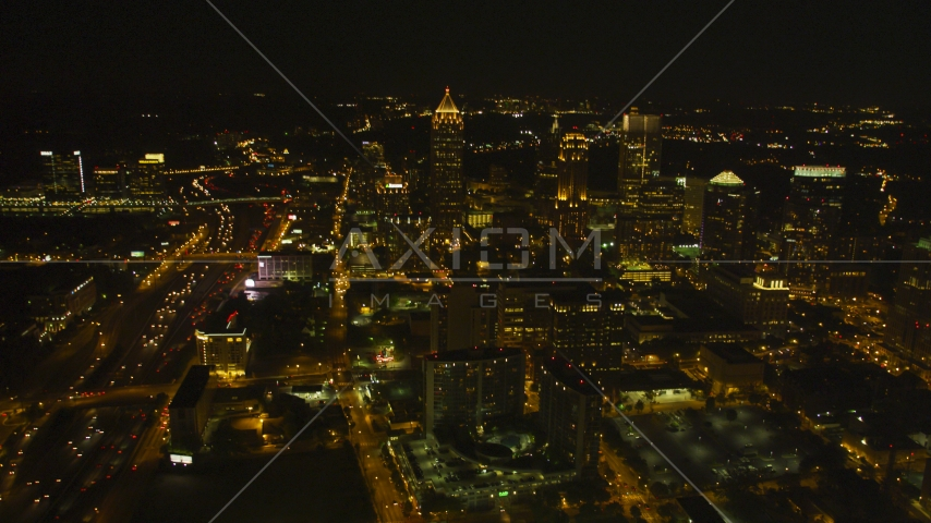 Tall skyscrapers and city buildings in Midtown Atlanta, Georgia, night Aerial Stock Photos | AX41_027.0000019F
