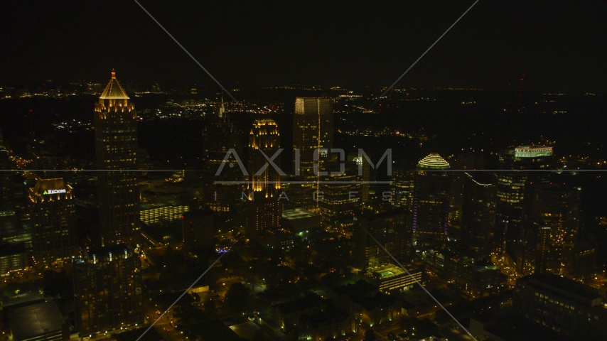 A group of skyscrapers at night in Midtown Atlanta, Georgia Aerial Stock Photos | AX41_028.0000078F