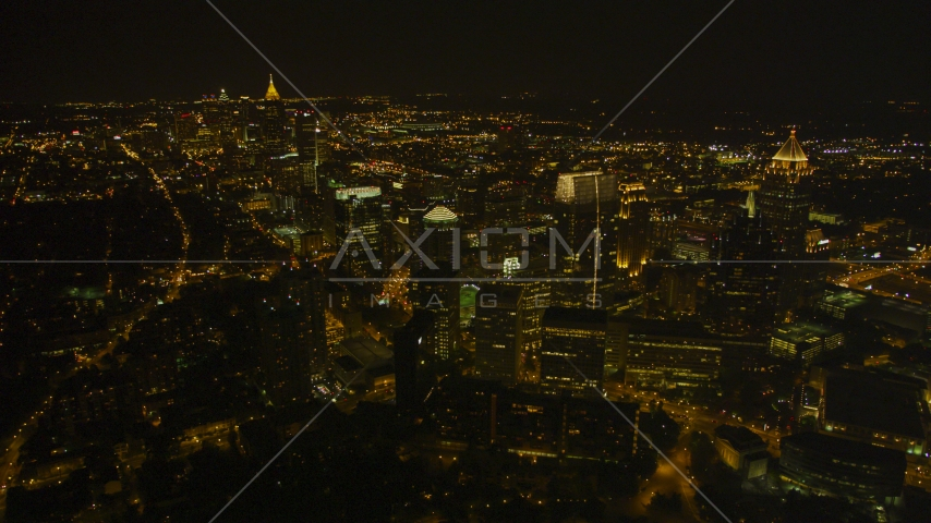 Wide view of skyscrapers and city sprawl, Midtown Atlanta, Georgia, night Aerial Stock Photos | AX41_072.0000000F