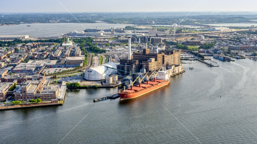 Cargo ship docked by the Domino Sugar Factory, Baltimore, Maryland Aerial Stock Photos | AXP073_000_0016F