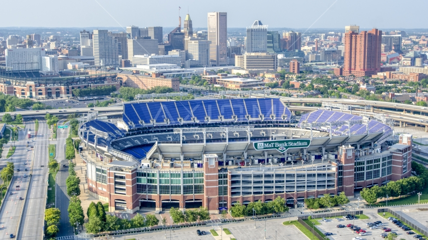 M&T Bank Stadium with Downtown Baltimore skyscrapers in the background, Maryland Aerial Stock Photos | AXP073_000_0021F