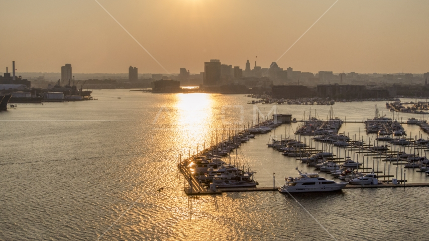 Downtown Baltimore skyline at sunset, seen from Baltimore Marine Center, Maryland Aerial Stock Photos | AXP073_000_0022F