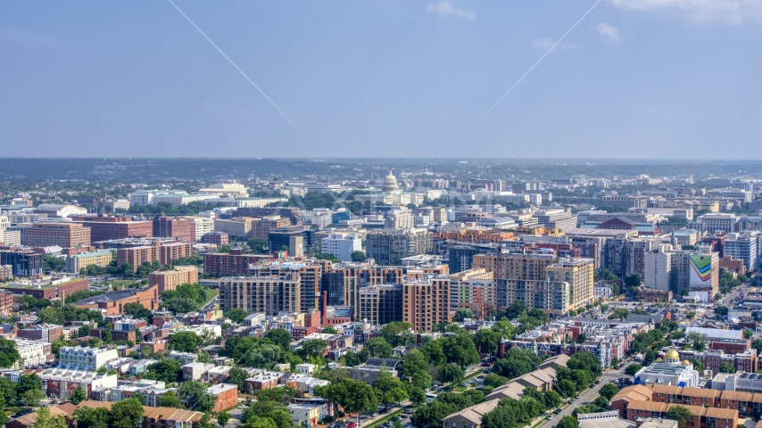 The United States Capitol seen from apartment complexes in Washington DC Aerial Stock Photos | AXP075_000_0013F