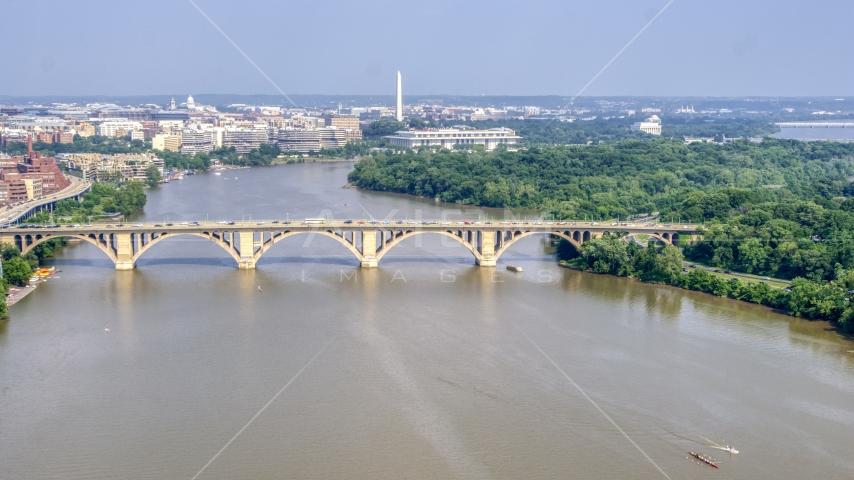 Francis Scott Key Bridge over the Potomac River, Washington Monument in background in Washington DC Aerial Stock Photos | AXP075_000_0017F