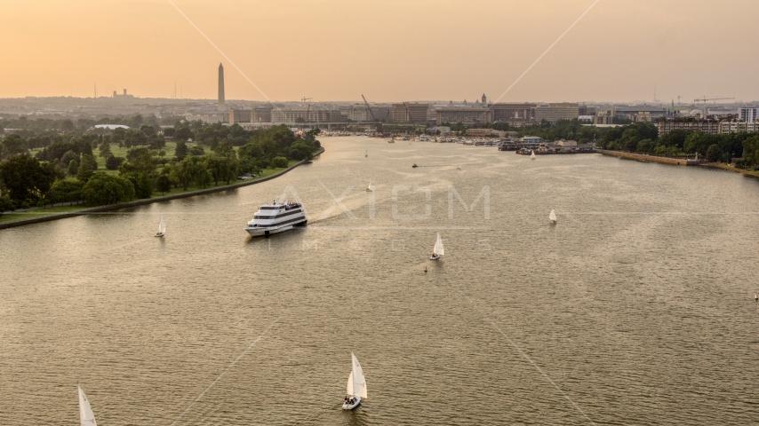 Sailboats and ferry on Washington Channel near Washington Monument, Washington D.C., sunset Aerial Stock Photos | AXP076_000_0006F