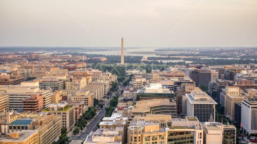 A wide view of the White House, Washington Monument, and Jefferson Memorial, Washington D.C., sunset Aerial Stock Photos | AXP076_000_0018F