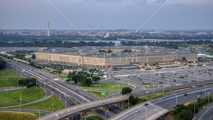 The Pentagon at twilight in Washington, D.C., with the Washington Monument in the distance Aerial Stock Photos   AXP076_000_0024F