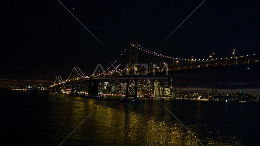 The Bay Bridge in front of the Downtown San Francisco skyline, California, night Aerial Stock Photos | DCSF06_002.0000085