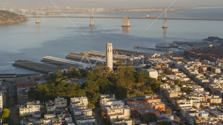 Coit Tower with Bay Bridge in background, North Beach, San Francisco, California, sunset Aerial Stock Photos | DCSF07_008.0000069