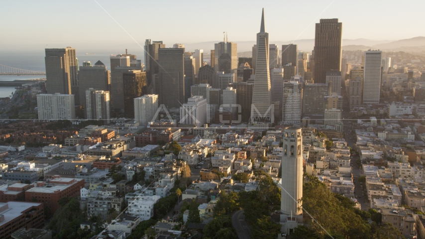 Coit Tower and the Financial District skyline, Downtown San Francisco, California, sunset Aerial Stock Photo DCSF07_009.0000172 | Axiom Images