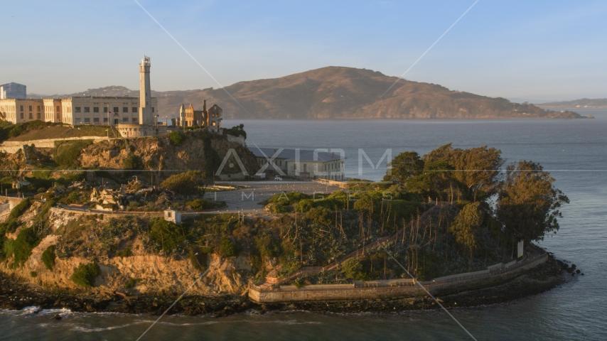 Alcatraz lighthouse and part of the island in San Francisco, California, sunset Aerial Stock Photos | DCSF07_033.0000000