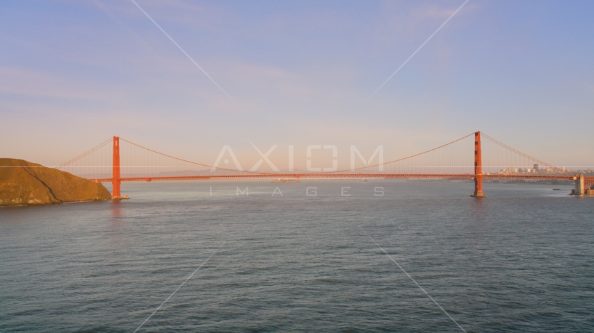 Wide view of the Golden Gate Bridge at sunset in San Francisco, California Aerial Stock Photos | DCSF07_047.0000002