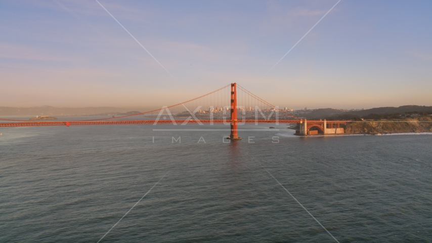 The Golden Gate Bridge with Downtown San Francisco skyline behind it, California, sunset Aerial Stock Photos | DCSF07_048.0000059