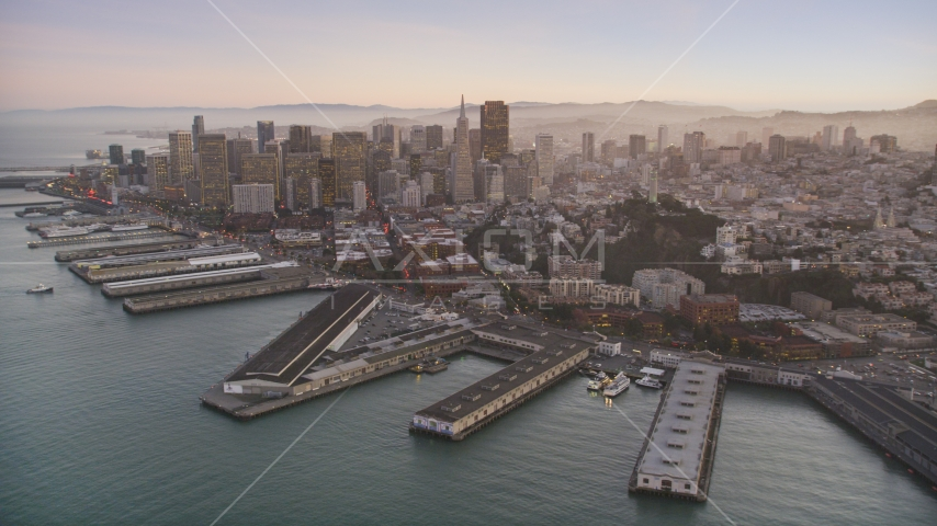 Piers by Coit Tower, and Downtown San Francisco skyscrapers, California, twilight Aerial Stock Photos | DCSF07_081.0000283