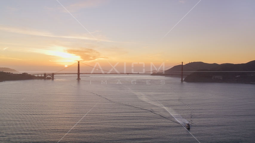Setting sun behind the Golden Gate Bridge, San Francisco, California, sunset Aerial Stock Photos | DCSF10_025.0000033