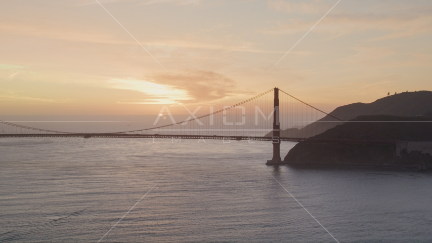 Golden Gate Bridge with setting sun in the distance, San Francisco, California, sunset Aerial Stock Photos | DCSF10_026.0000139