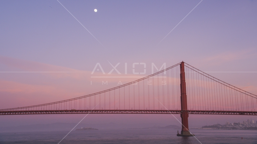 The moon above the Golden Gate Bridge at twilight in San Francisco, California Aerial Stock Photos | DCSF10_030.0000481
