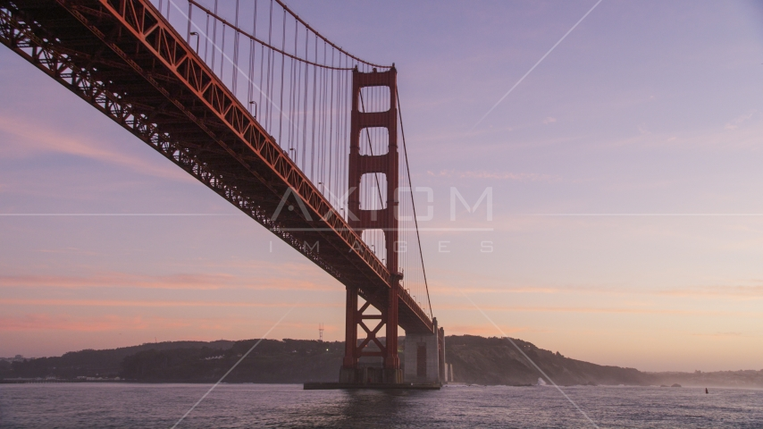 A Golden Gate Bridge tower in San Francisco, California, twilight Aerial Stock Photos | DCSF10_035.0000000