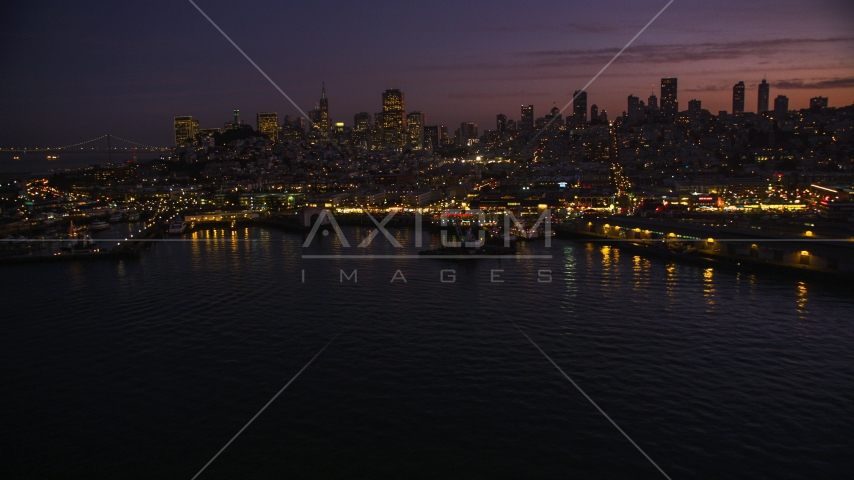 Fisherman's Wharf, with downtown skyline in the background, San Francisco, California, twilight Aerial Stock Photo DCSF10_055.0000451 | Axiom Images