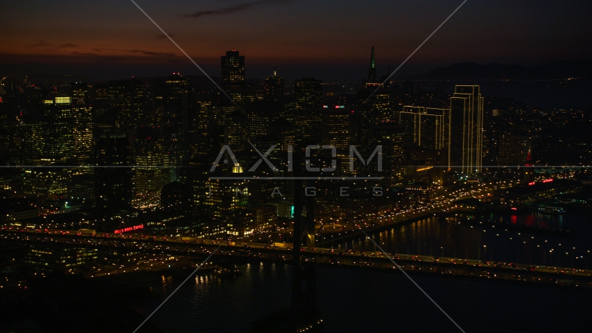 Heavy traffic on the Bay Bridge by Downtown San Francisco skyscrapers, California, night Aerial Stock Photos | DCSF10_071.0000539