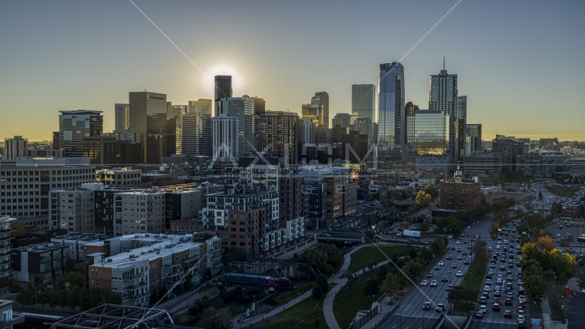 Skyscrapers of the city's skyline at sunrise, viewed from a park in Downtown Denver, Colorado Aerial Stock Photos | DXP001_000109