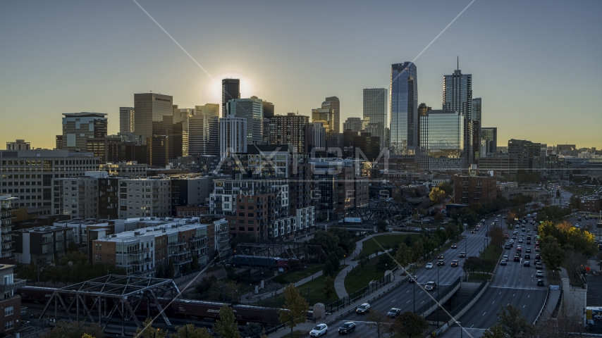 Skyscrapers of the city's skyline at sunrise, seen from busy street and park in Downtown Denver, Colorado Aerial Stock Photos | DXP001_000112