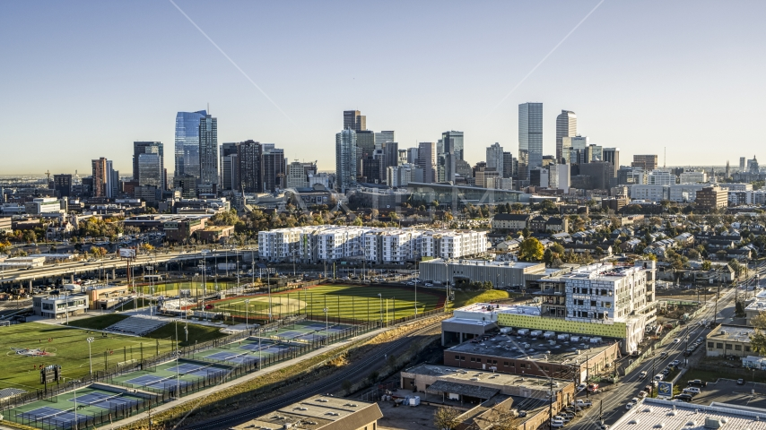 City skyline behind apartment buildings and sports fields, Downtown Denver, Colorado Aerial Stock Photos | DXP001_000119