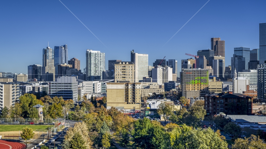Part of city's skyline seen from trees, Downtown Denver, Colorado Aerial Stock Photos | DXP001_000125