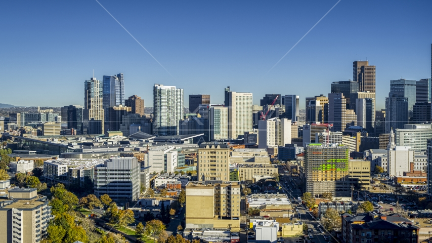 Part of the city's skyline behind office buildings, Downtown Denver, Colorado Aerial Stock Photos DXP001_000127 | Axiom Images