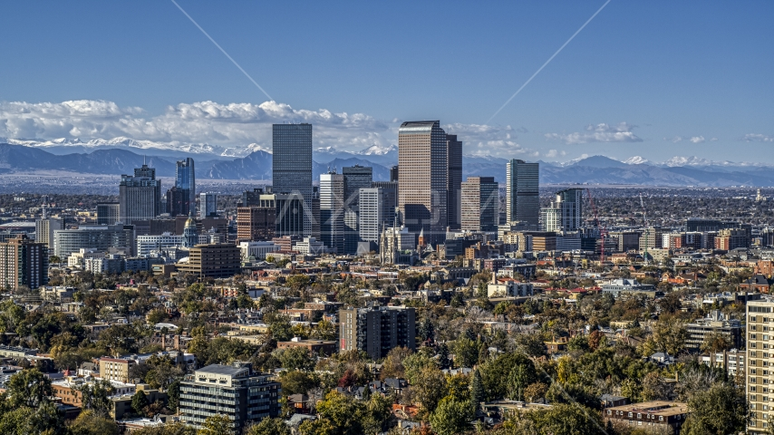 View across the city at the skyline of Downtown Denver, Colorado Aerial Stock Photo DXP001_000158 | Axiom Images