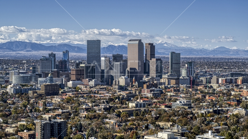 View across the city at the skyline's tall skyscrapers, Downtown Denver, Colorado Aerial Stock Photo DXP001_000159 | Axiom Images