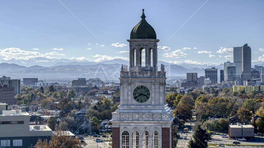 A tall clock tower, part of downtown skyline in background, Denver, Colorado Aerial Stock Photos | DXP001_000162