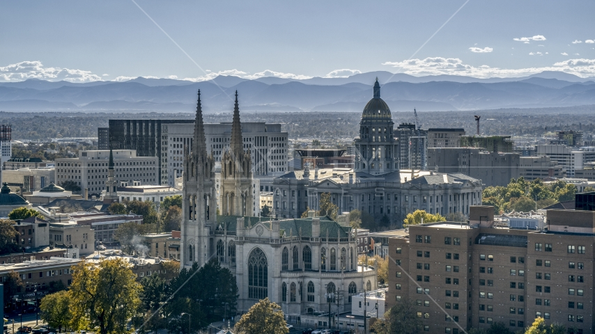 The Colorado State Capitol behind a cathedral, Downtown Denver, Colorado Aerial Stock Photo DXP001_000164 | Axiom Images