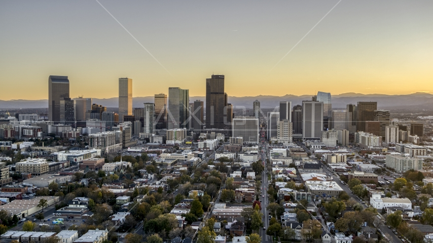 Wide view of the city's skyline at sunset, Downtown Denver, Colorado Aerial Stock Photos | DXP001_000182