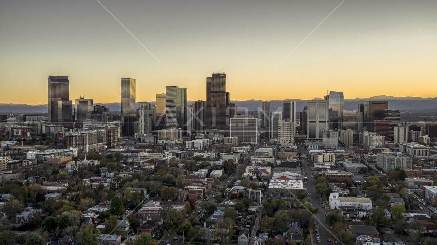 Wide view of the city's downtown skyline at sunset, Downtown Denver, Colorado Aerial Stock Photos | DXP001_000183