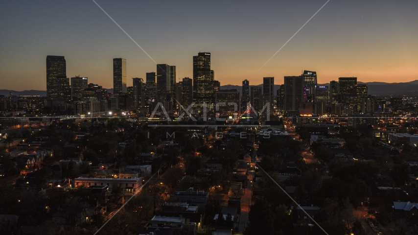 Giant skyscrapers in the city's skyline at twilight, Downtown Denver, Colorado Aerial Stock Photos DXP001_000191 | Axiom Images