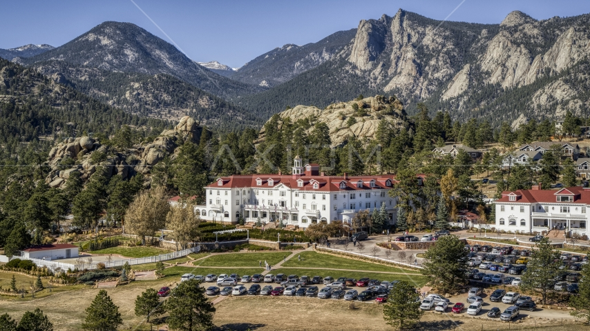 The historic Stanley Hotel, and mountains in the background in Estes Park, Colorado Aerial Stock Photos | DXP001_000211