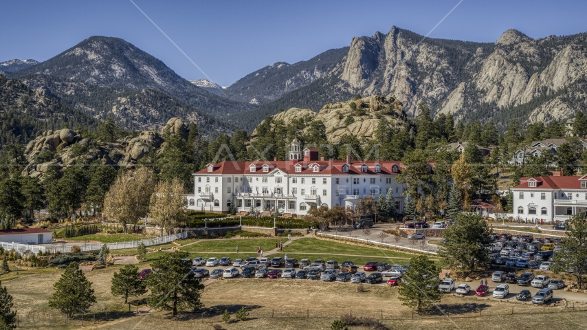 The famous Stanley Hotel, and mountains in the background in Estes Park, Colorado Aerial Stock Photos | DXP001_000212